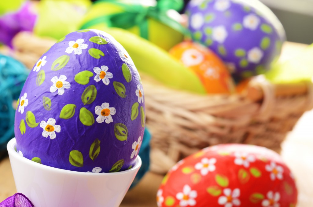 Hand crafted easter eggs in wicker basket